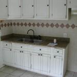 Kitchen with tile flooring and tiled backsplash