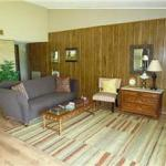 Great living area features a brick fireplace & laminate flooring
